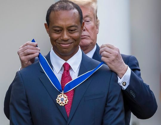 Tiger Woods receiving Presidential Medal of Freedom
